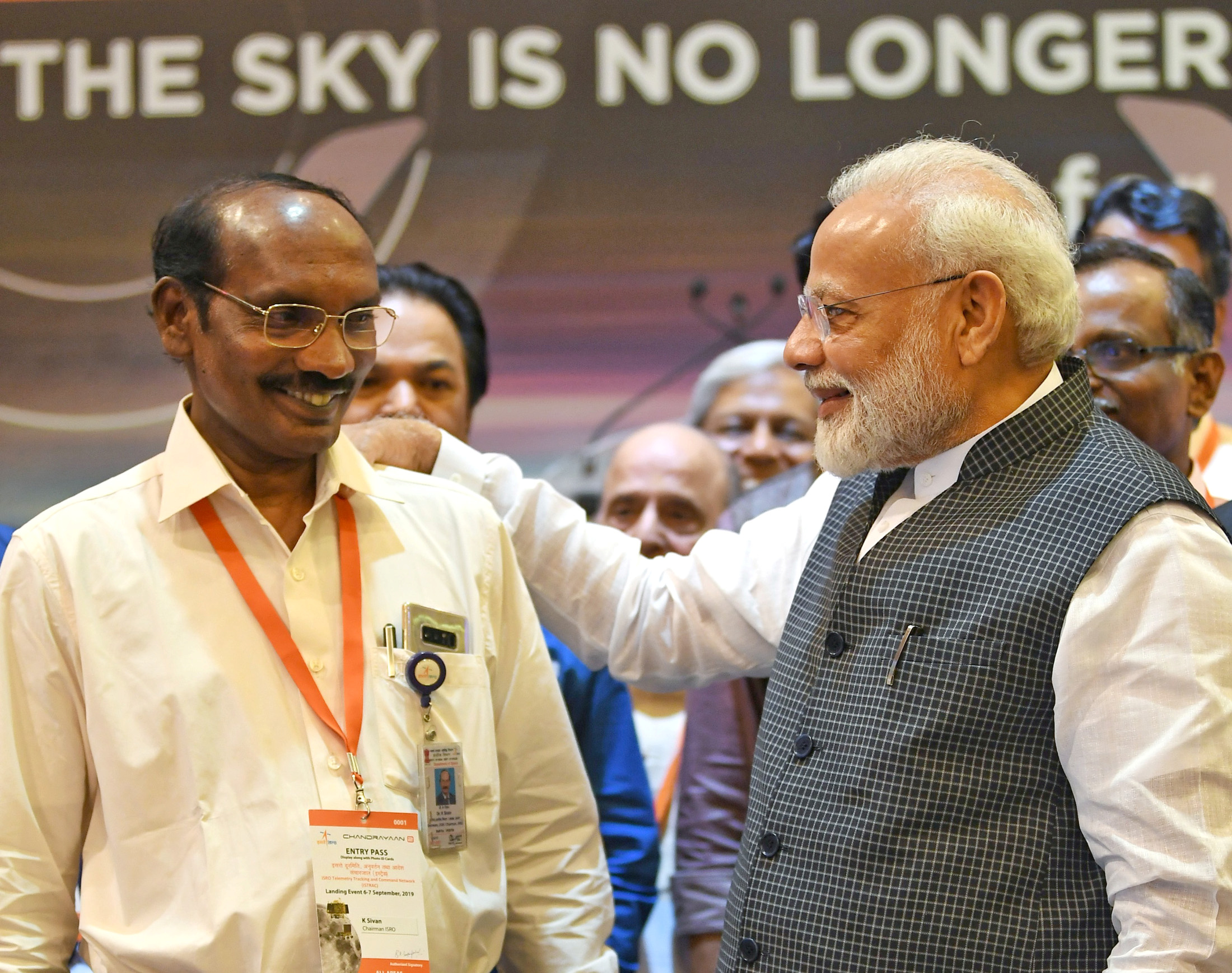 India's Prime Minister Narendra Modi talks to Kailasavadivoo Sivan, chairperson of the Indian Space Research Organization (ISRO) at their headquarters in Bengaluru