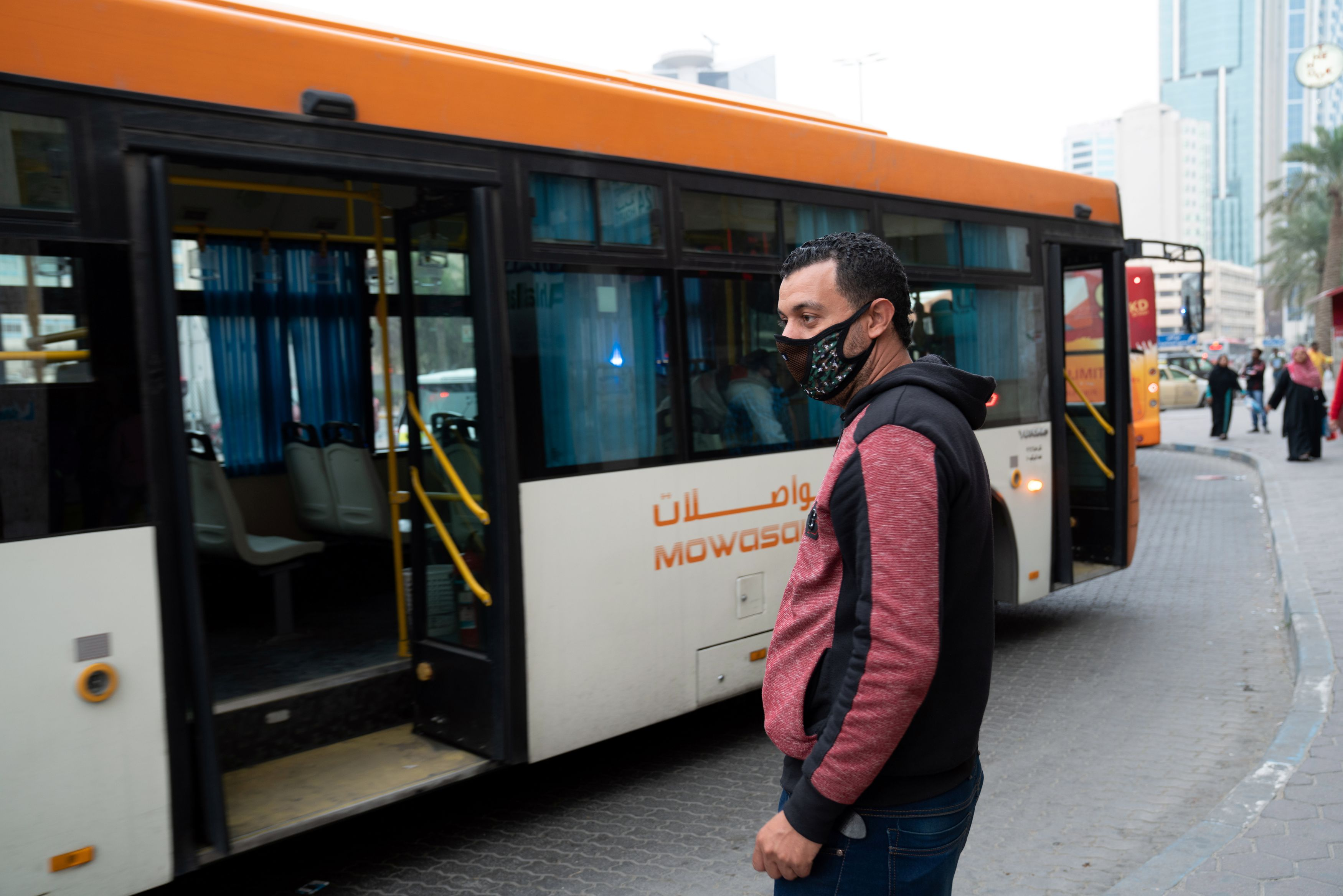 A man wears protective face mask, following the outbreak of the new coronavirus, in Kuwait