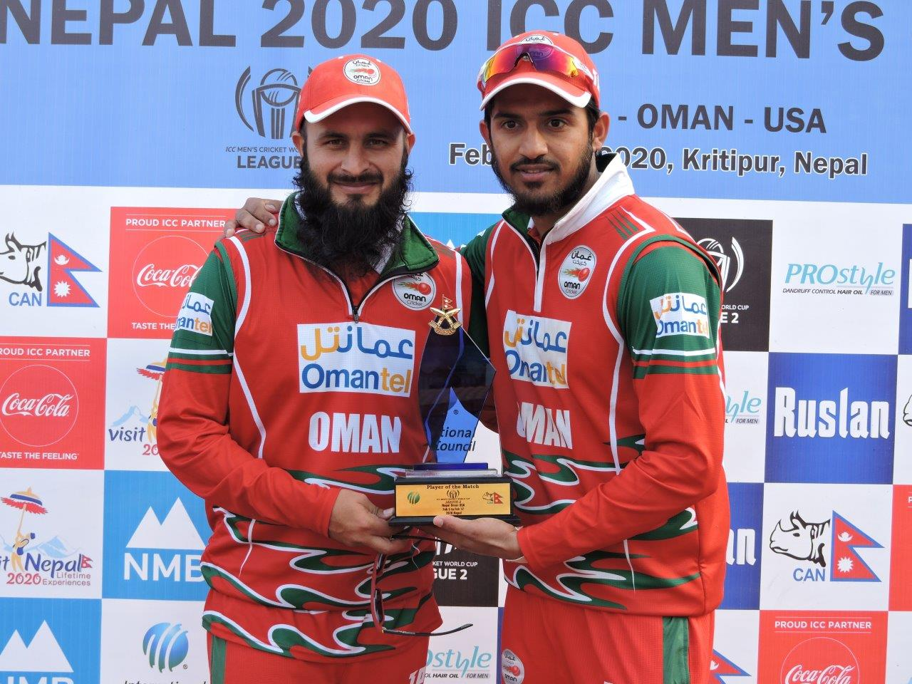 Player of the match Aqib with captain Zeeshan Maqsood